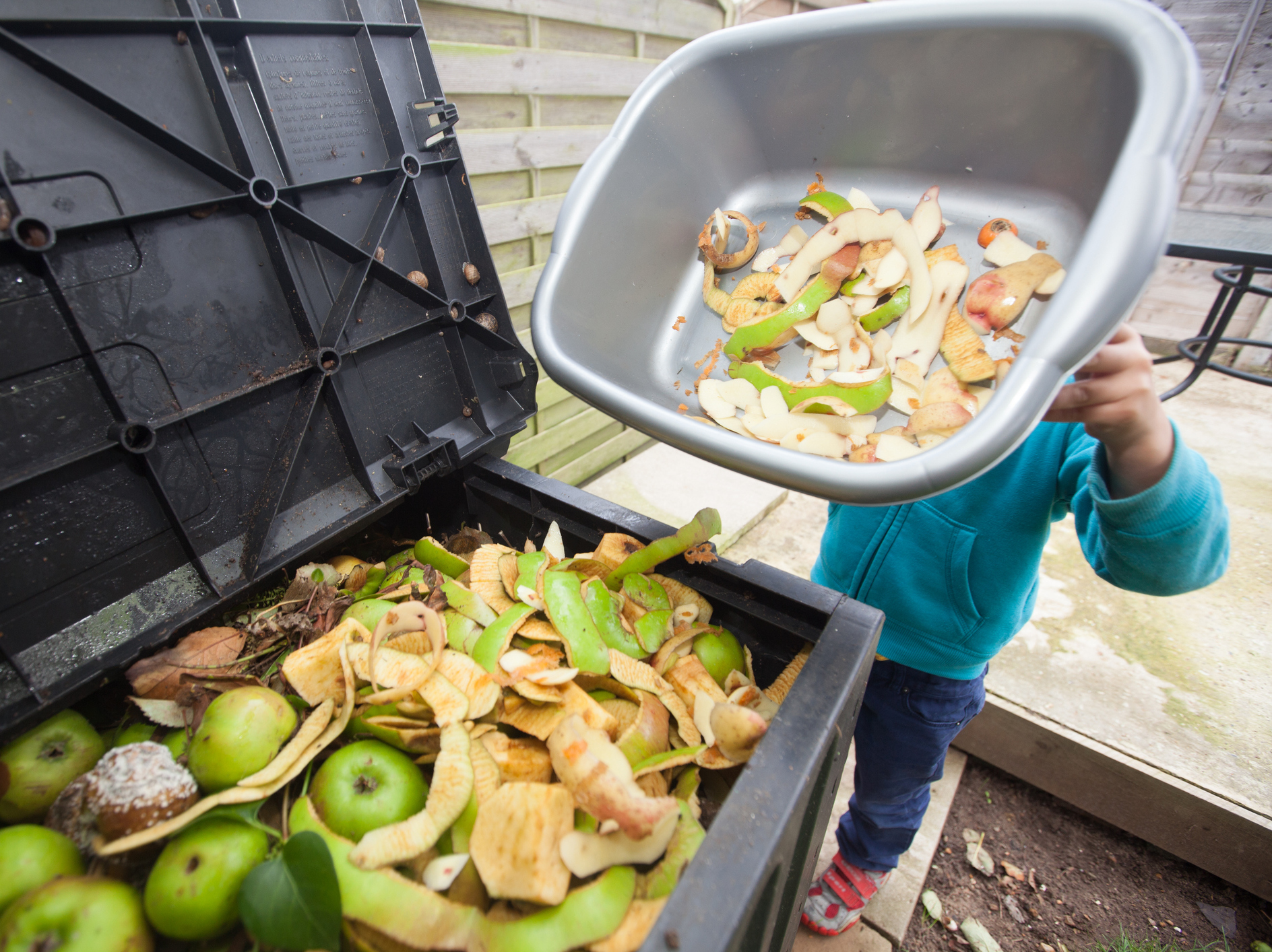 Composting food scraps is one way to reduce food waste, but preventing excess food in the first place is better, says the EPA. (paul mansfield photography/Getty Images)