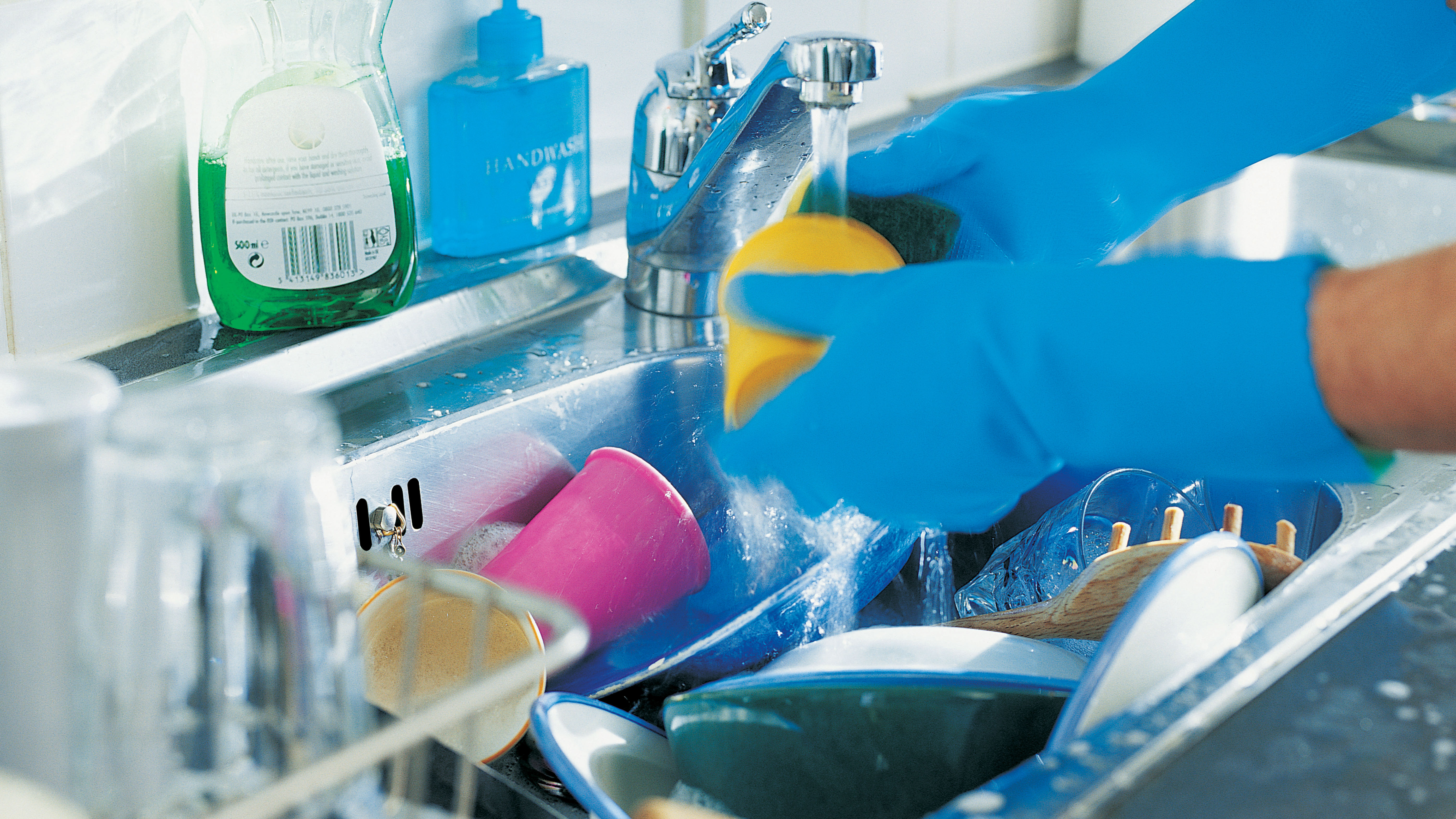 In the division of household tasks, one study shows that washing dishes is the category with the biggest discrepancy between men and women. (Alex Wilson/Getty Images)