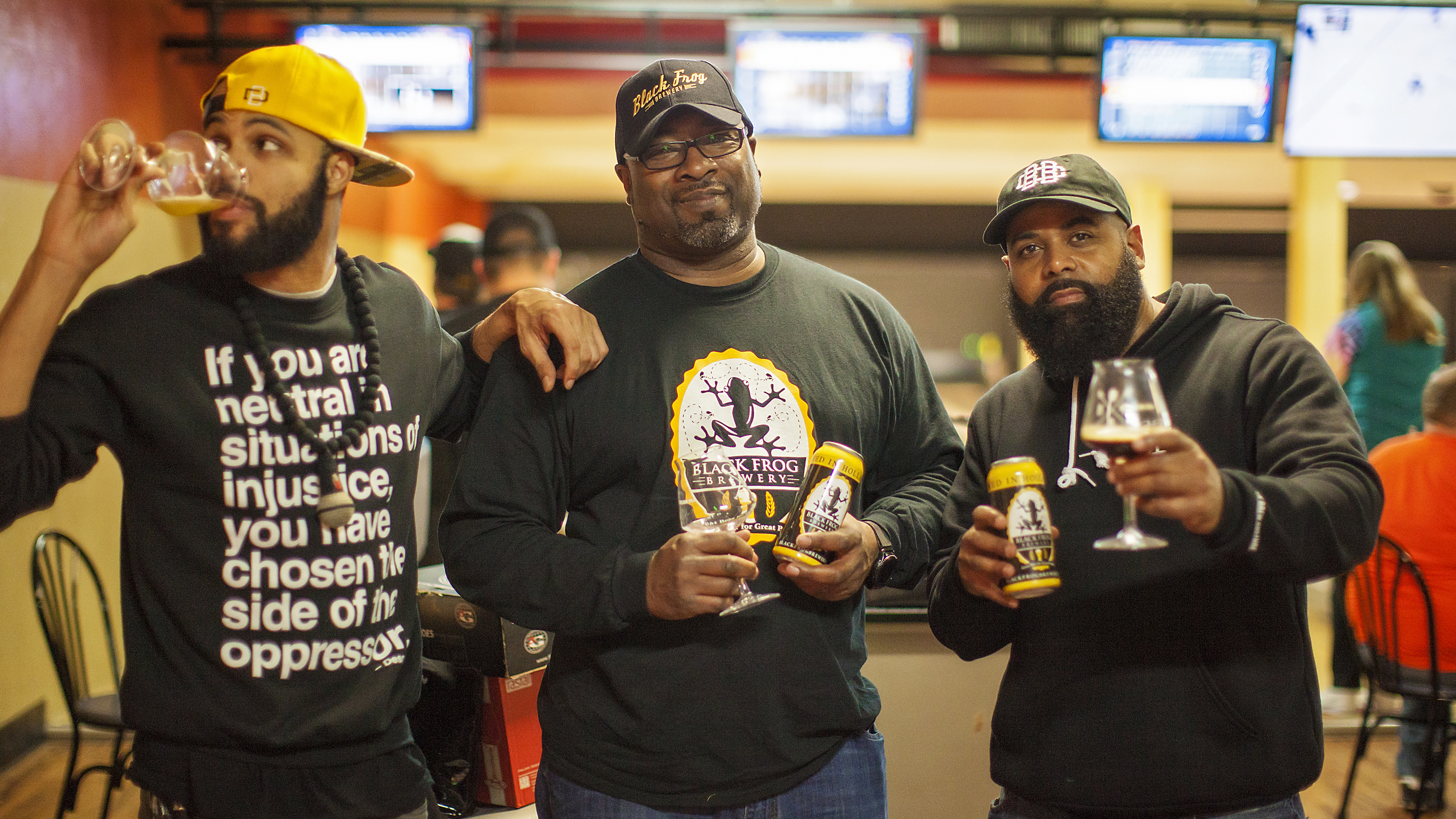 Fresh Fest co-founders Day Bracey (left) and Mike Potter (right) visit with Chris Harris, owner of Black Frog Brewery in Holland, Ohio, near Toledo. (Jeff Zoet/Courtesy Day Bracey)