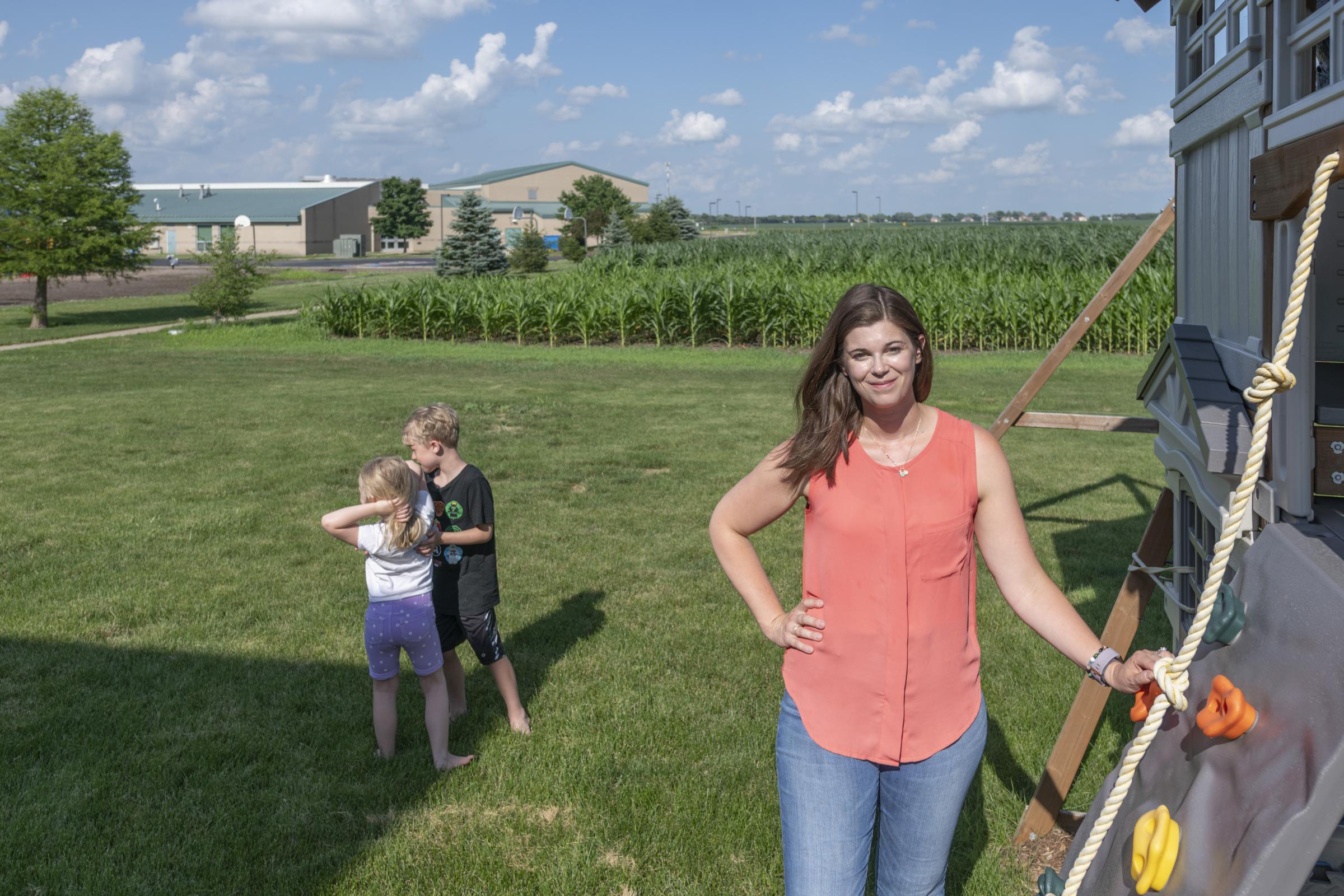Laura Whetherell has three kids and lives next to a cornfield in Champaign, Illinois. Her kids either attend or will attend Barkstall Elementary, which has a playground that borders the same cornfield (back left).DARRELL HOEMANN / MIDWEST CENTER FOR INVESTIGATIVE REPORTING