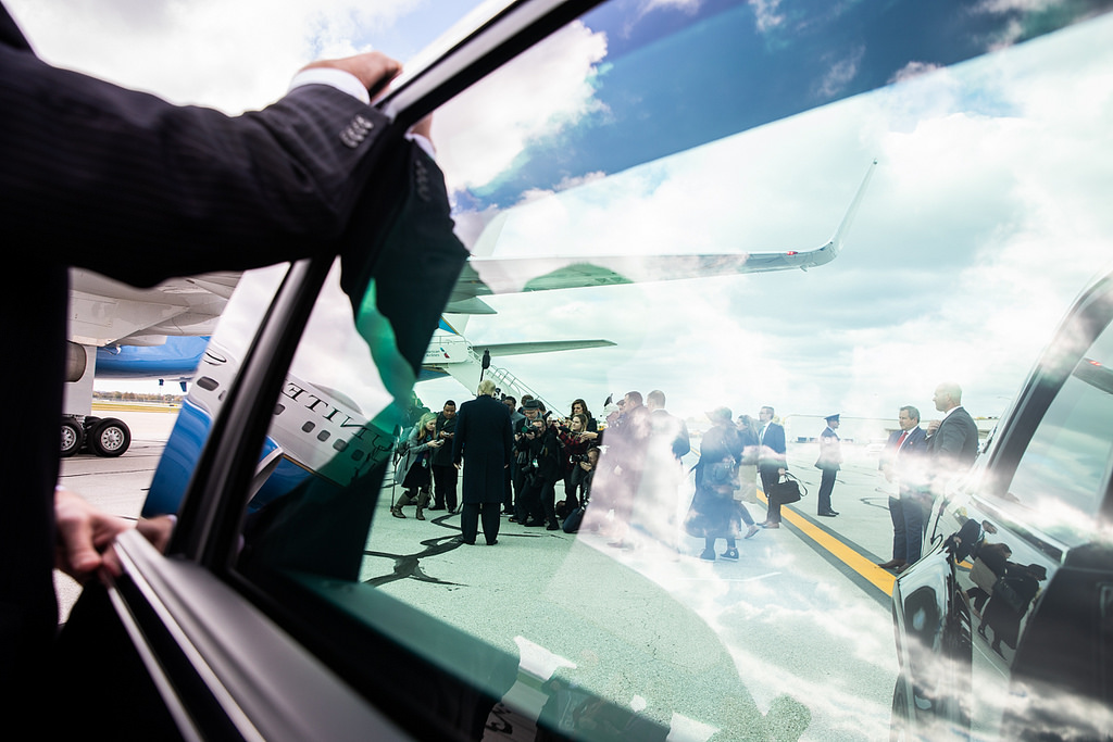 President Donald J. Trump is seen in the reflection of his limousine window greeting supporters Saturday, Oct. 27, 2018, as he arrives at Indianapolis International Airport, to address the Future Farmers of America convention in Indianapolis. (Official White House Photo by Shealah Craighead)