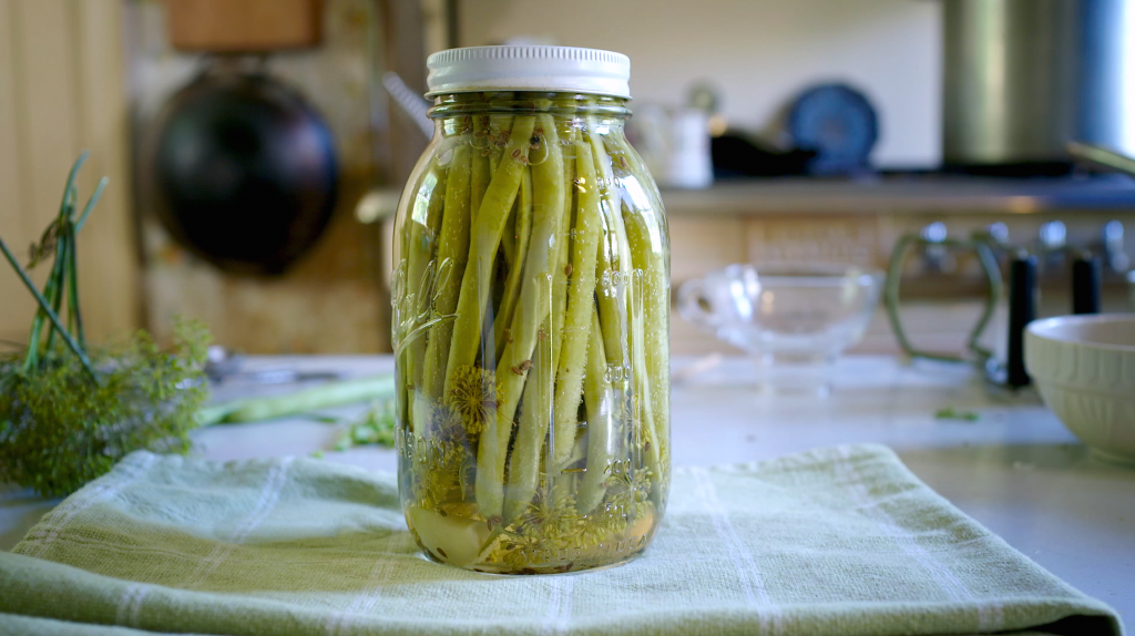 If using long green beans that fill a quart jar  you will need to double the brine in the recipe in order to have enough (PBS Food).