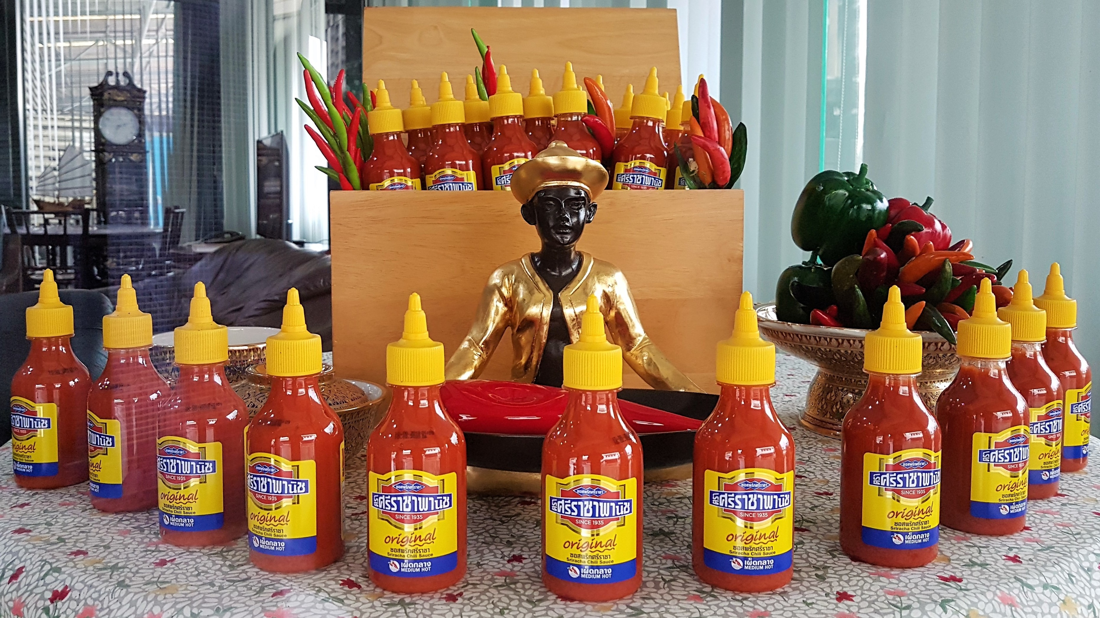 Sriraja Panich is the brand name of one of two Sriracha sauces created by Saowanit Trikityanukul's family. The family sold the brand to Thaitheparos, Thailand's leading sauce company, in the 1980s. The brand has struggled to gain a foothold in the U.S., where the Huy Fong Rooster brand of Sriracha, created by Vietnamese-American David Tran, reigns supreme. (Michael Sullivan/for NPR)