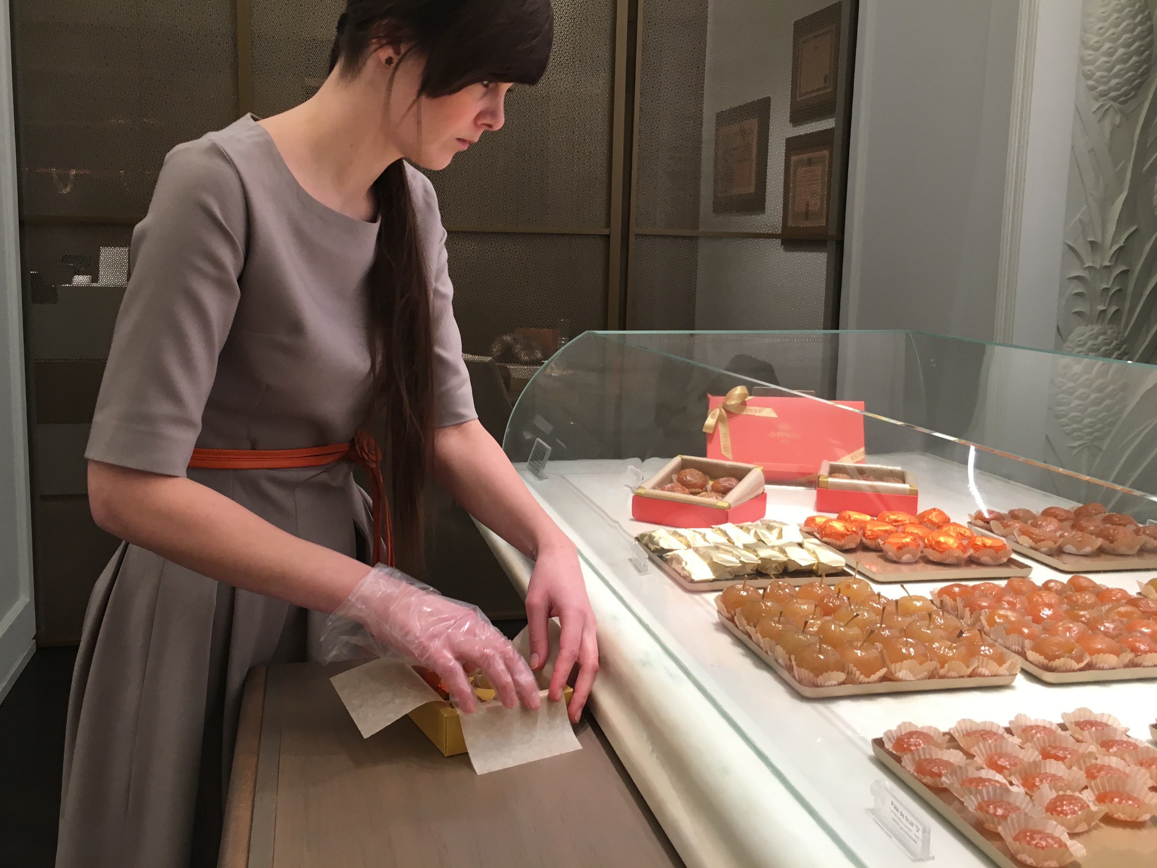 """""""The customers, they are curious ... and they ask, 'What makes this chocolate special?'"""" says sales associateNoemi Czinkoczky. """"And we tell them how much effort goes into each piece of chocolate. (Joanna Kakissis/NPR)"""