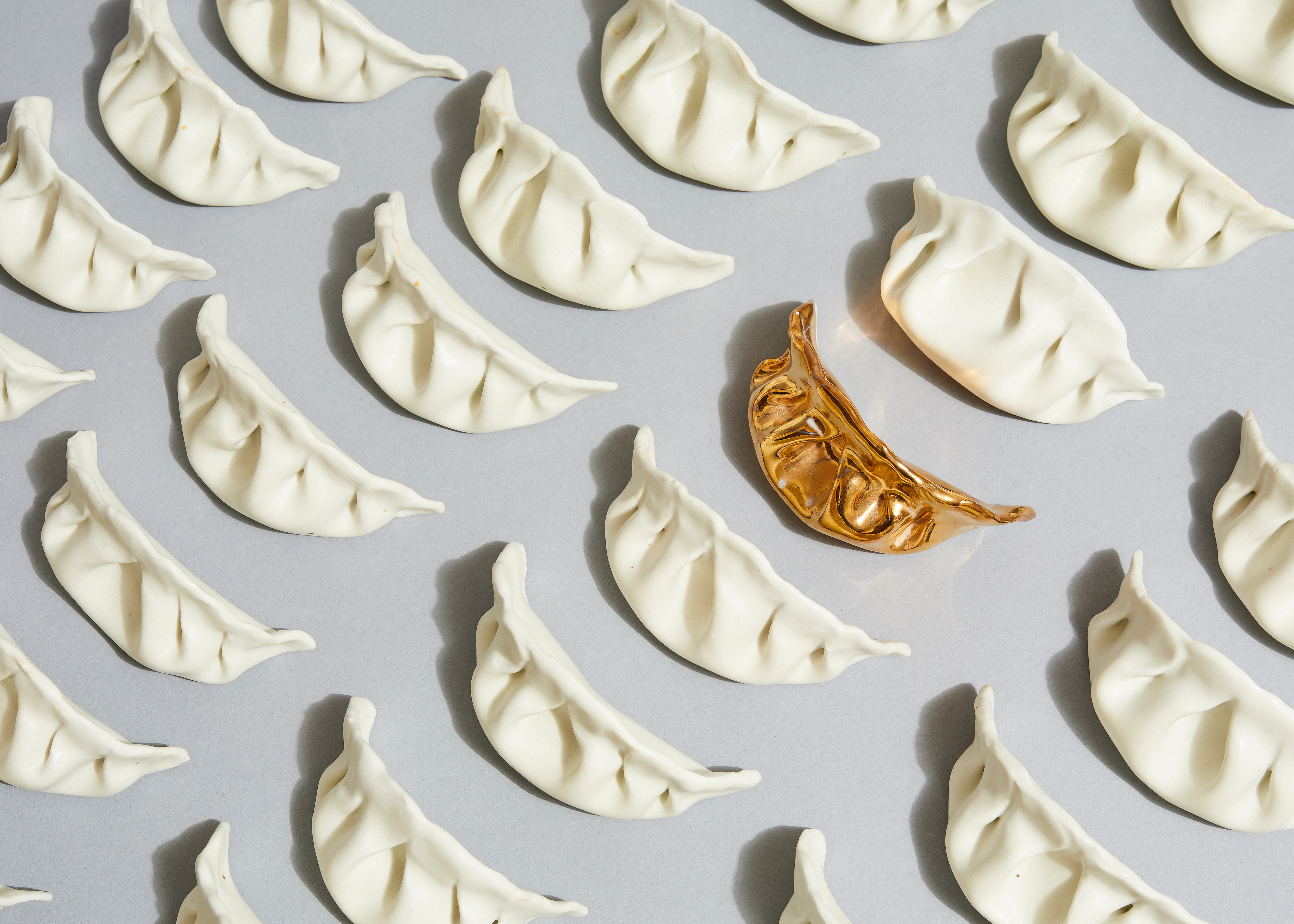 Artist Stephanie Shih remembers making pork-filled dumplings with her family and started her art project by sculpting six of them out of porcelain. She's now made 600. (Courtesy of Robert Bredvad)