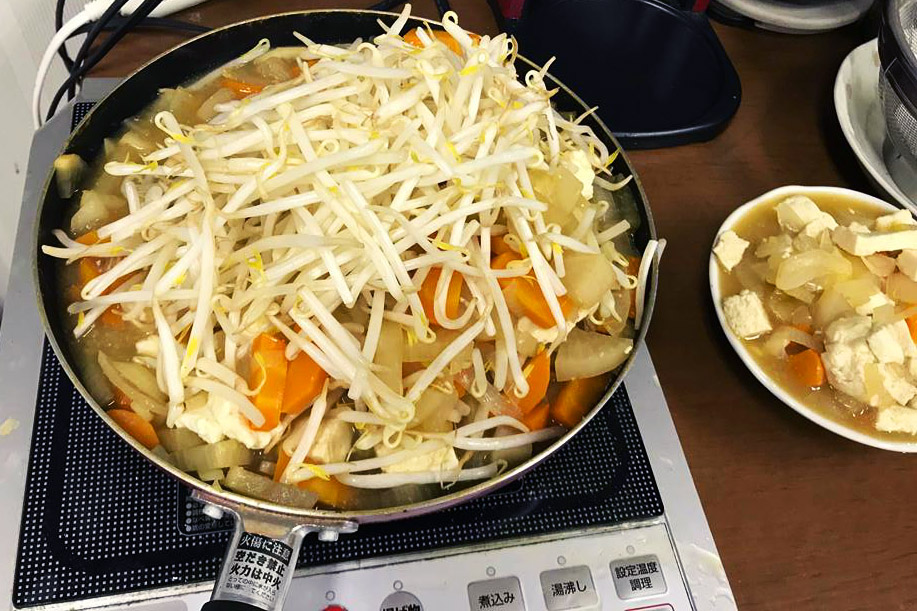 David Gann regularly prepares Nabe (a Japanese dish packed with vegetables) on an induction burner in his office.  (David Gann)