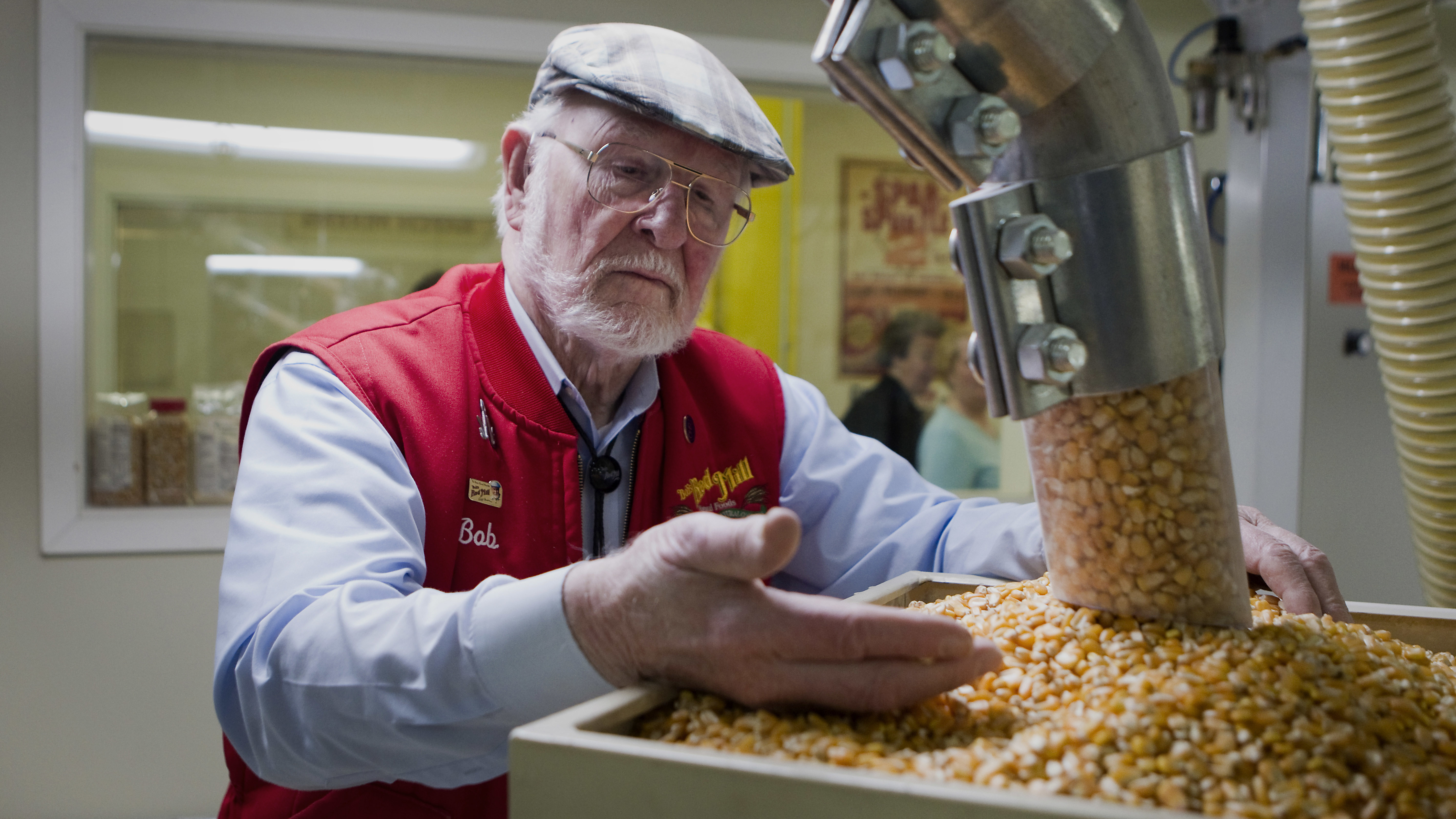 Bob Moore, founder of Bob's Red Mill Natural Foods, inspects grains at the company's facility in Milwaukie, Ore. The pioneering manufacturer of gluten-free products invests in whole grains as well as beans, seeds, nuts, dried fruits, spices and herbs. (Natalie Behring/Bloomberg via Getty Images)
