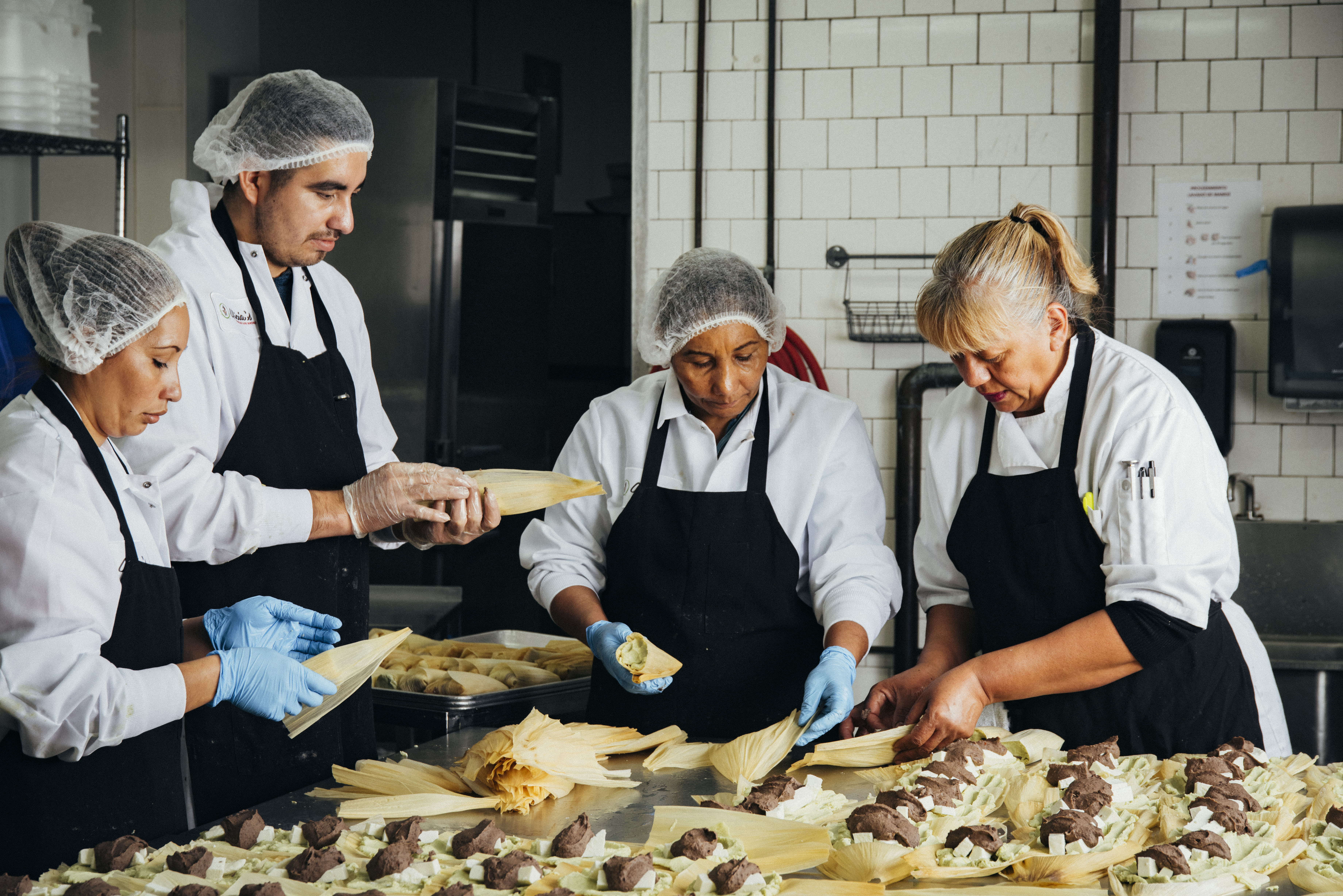 From left: Gloria Amaya, José Amaya, Silvia Gómez, and Alicia Villanueva, the founder of Tamales Los Mayas. A graduate of La Cocina's program for food entrepreneurs, Villanueva now provides catering to scores of Bay Area companies each month, and her tamales are sold in Northern California Whole Foods store (Eric Wolfinger)