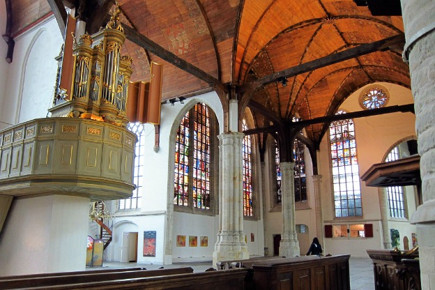 An interior photograph of the Oude Kerk in Amsterdam.