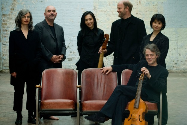 Members of Fretwork. From left to right: Susanna Pell, Richard Tunnicliffe, Reiko Ichise, Richard Boothby, and Asako Morikawa. Seated: former member Richard Campbell who passed away in March 2011.