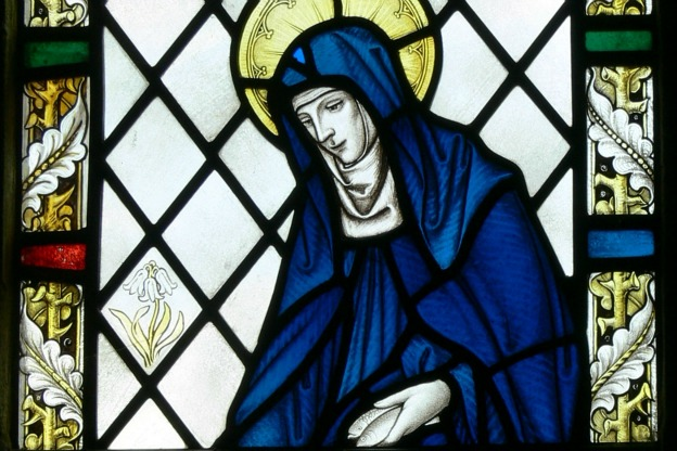 Detail of a stained glass window showing Saint Brigid of Kildare at Our Lady and Saint Non's Chapel in St Davids, Wales.