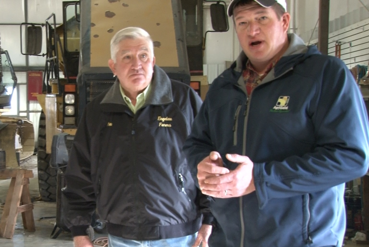 Harold and Ed Engelau stand in outbuilding