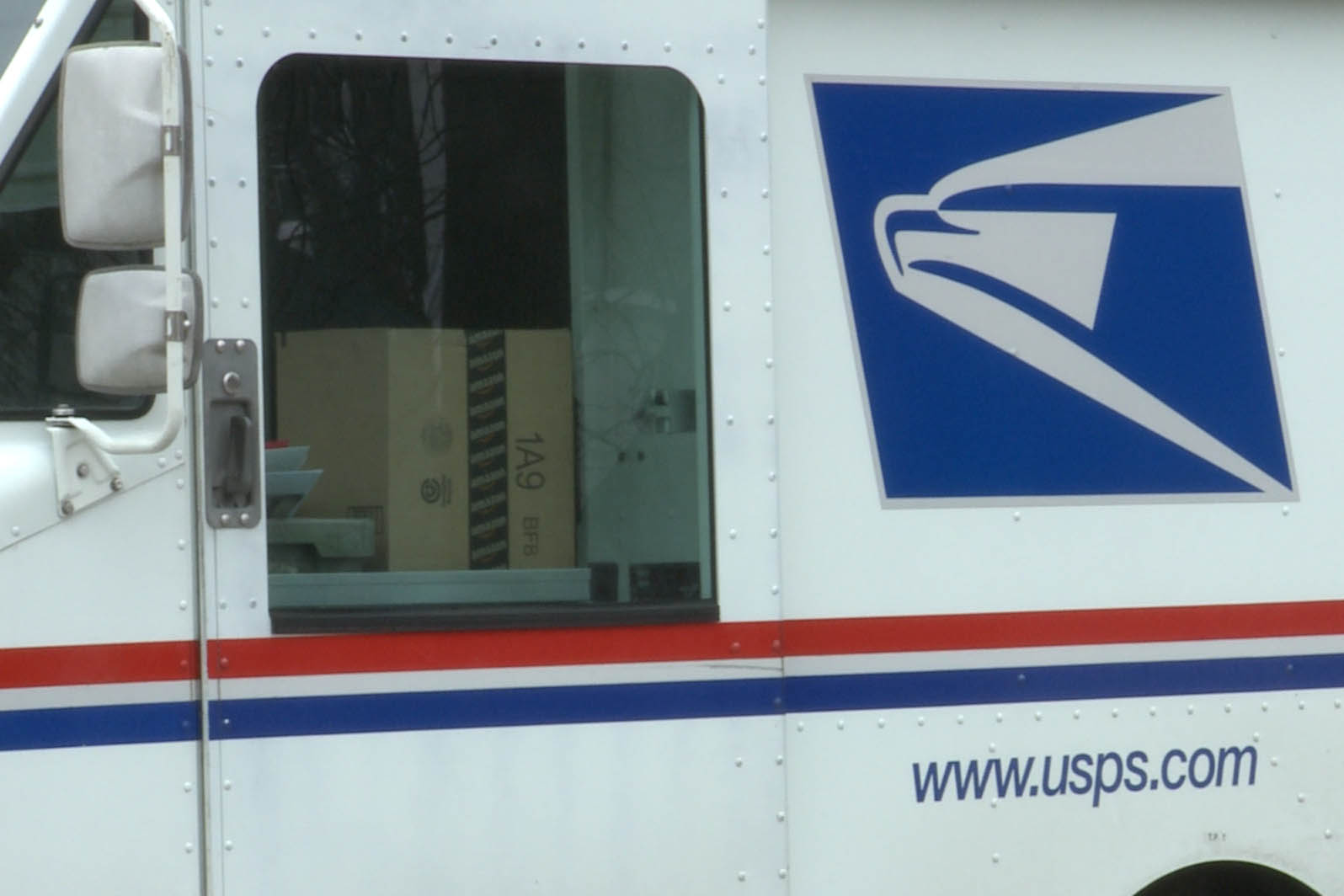 A mail truck in Bloomington makes a stop to deliver mail.