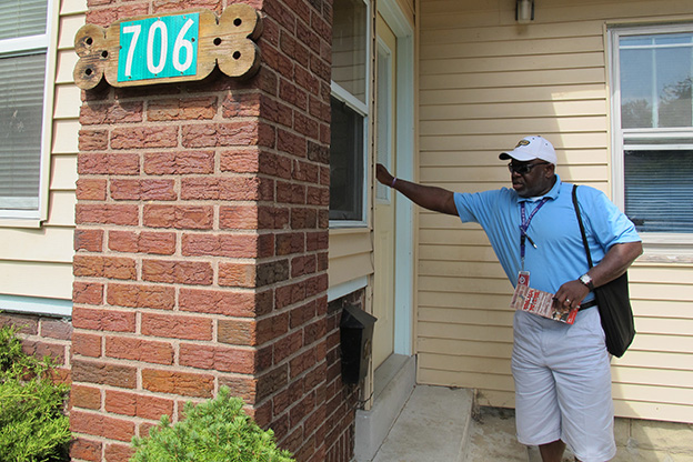 Henry Jordan, a dean at George Washington Community High School, knocks on the door of a home on Indianapolis' Near Eastside in July 2012. Jordan, an Indianapolis Public Schools employee, was part of a team canvassing the city looking to encourage IPS dropouts to re-enroll.