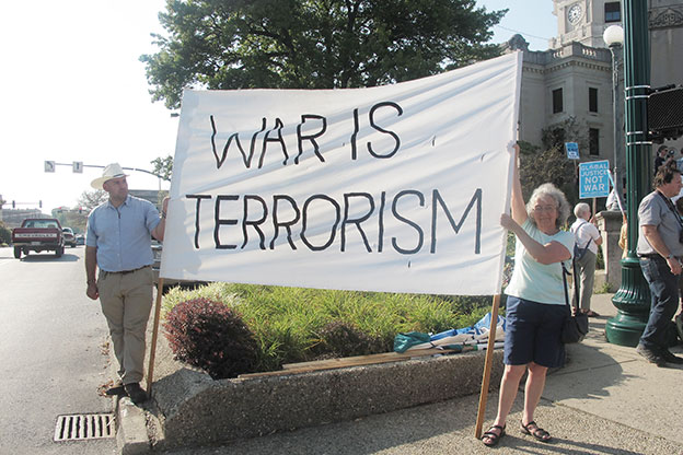 """Huge """"War is Terrorism"""" banner by protesters"""