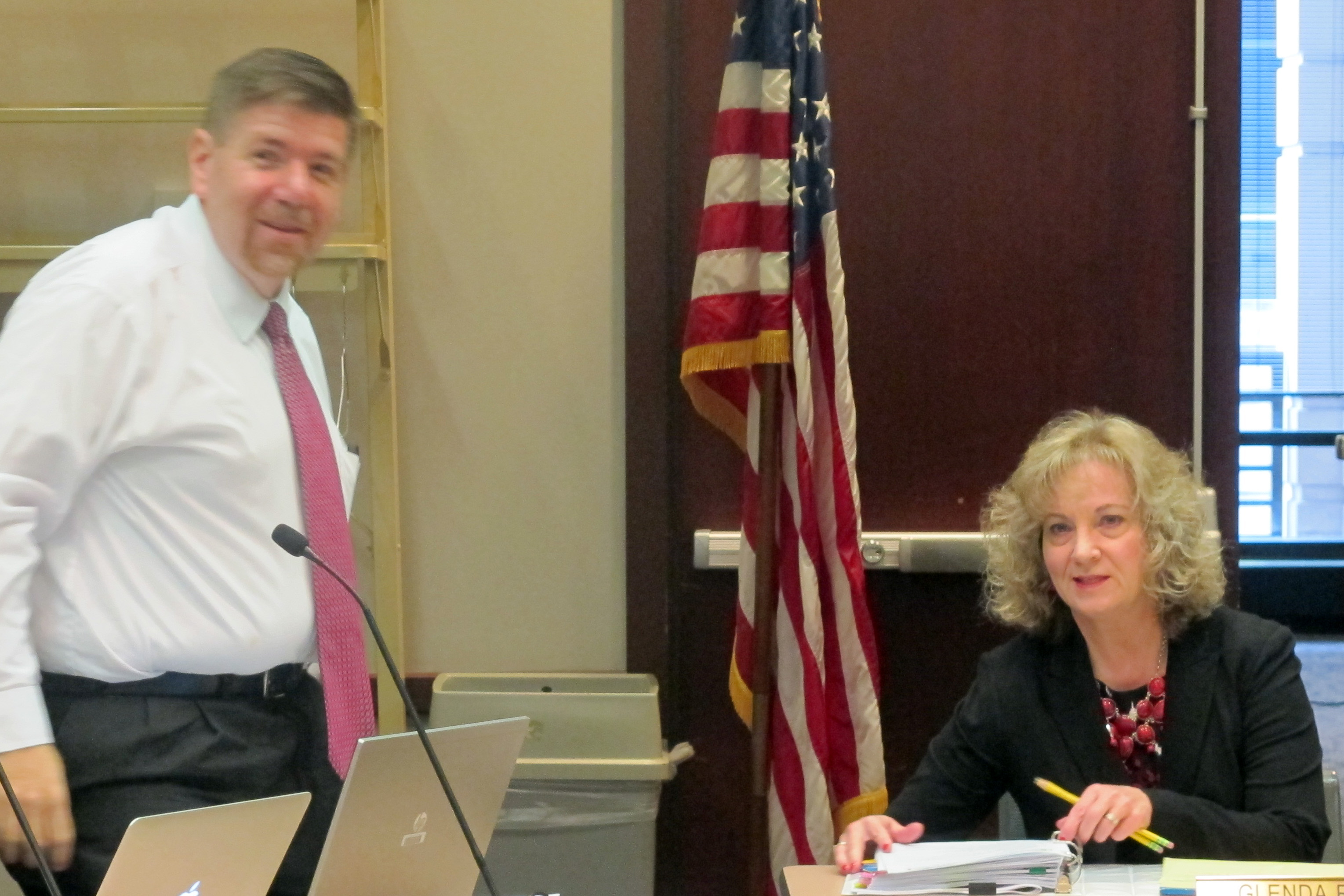 State Superintendent Glenda Ritz, right, and board member Brad Oliver take their seats before the October meeting.