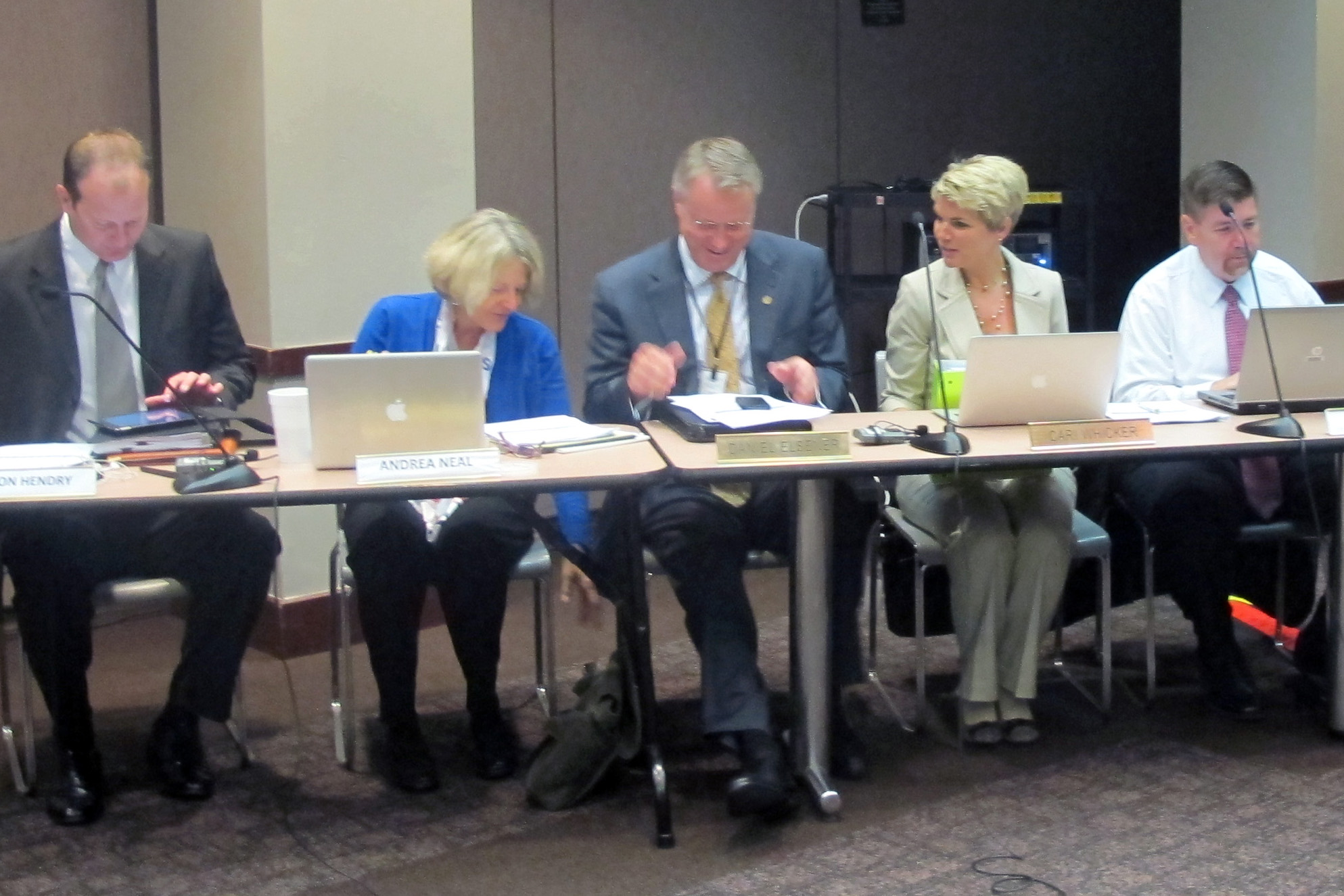 State Board of Education members Gordon Hendry, left, Andrea Neal, Dan Elsener, Cari Whicker and Brad Oliver listen to a presentation during the October meeting.