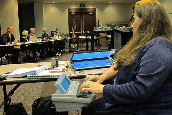 A court reporter transcribes the events of the State Board of Education meeting, even though state superintendent Glenda Ritz had declared the meeting adjourned without a vote of the panel.