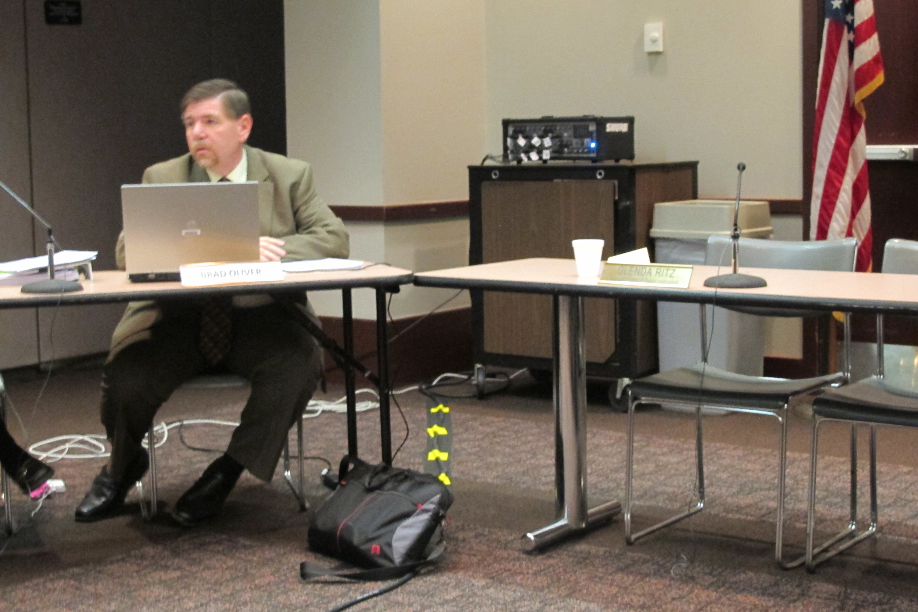 State Board of Education member Brad Oliver remains seated after state superintendent Glenda Ritz adjourned Wednesday's meeting without a vote of the panel.