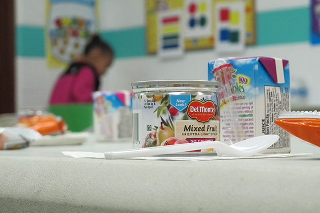 """An after-school snack sits on a table waiting for students an East Chicago community center classroom. It's part of the """"Hope Project,"""" an after-school """"nutrition and academic support program"""" a local food bank offers to students who qualify for government help paying for their meals in school."""