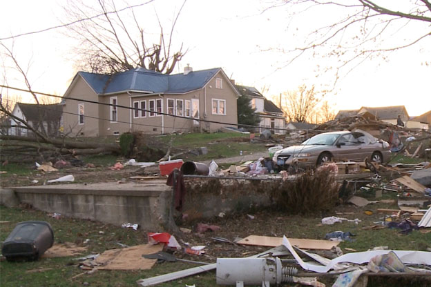 This ally in Washington, Indiana is usually lined with garages. The damage and debris in this area can be seen for several blocks.