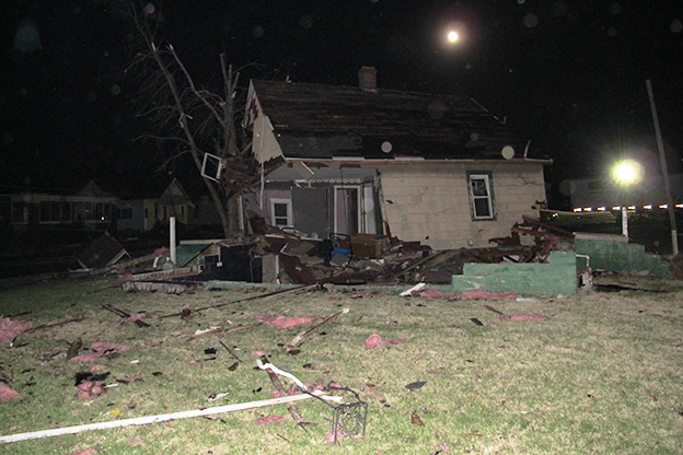 A tornado that ripped through Washington, Ind., twisted this home off of its foundation. A neighbor says its occupants moved out two weeks ago.