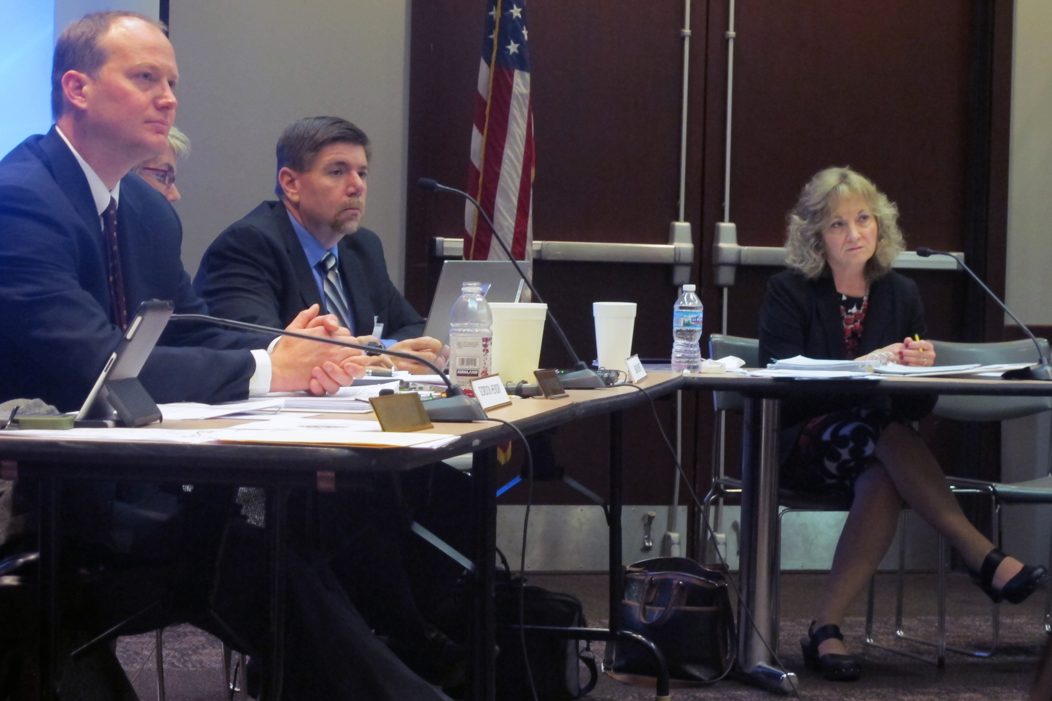 Board members Gordon Hendry, left, Brad Oliver and state superintendent Glenda Ritz listen to a presentation at the November State Board of Education meeting.