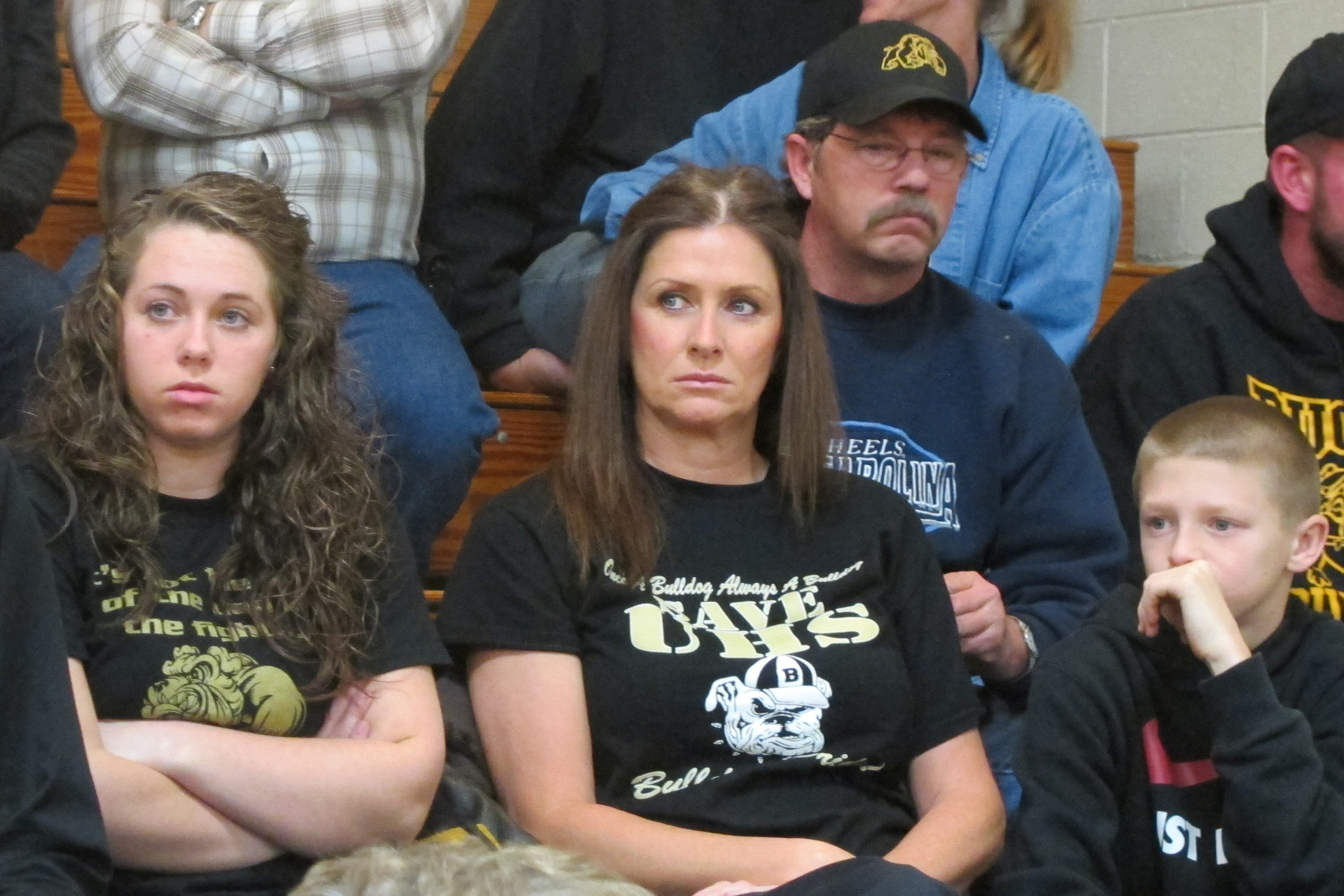 Supporters of keeping Union Junior-Senior High School and Dugger Elementary open listen during a Northeast School Corporation Board of Trustees meeting.