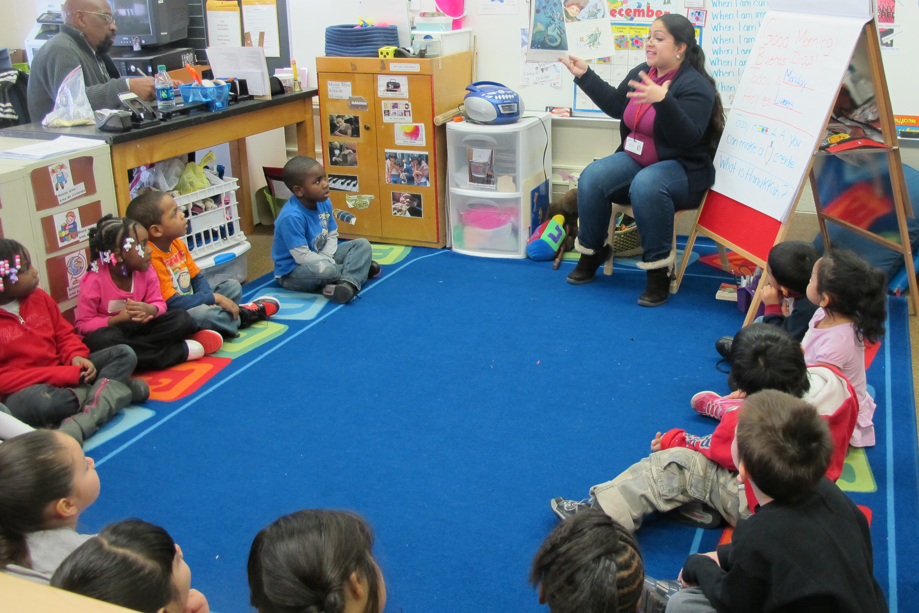 A Head Start teacher in South Bend reads to her class of 4-year-olds.