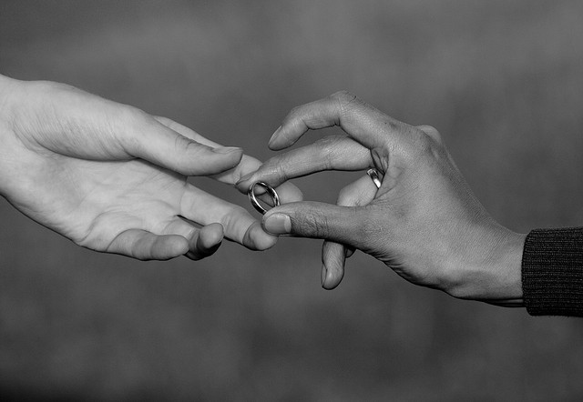 hands exchanging rings