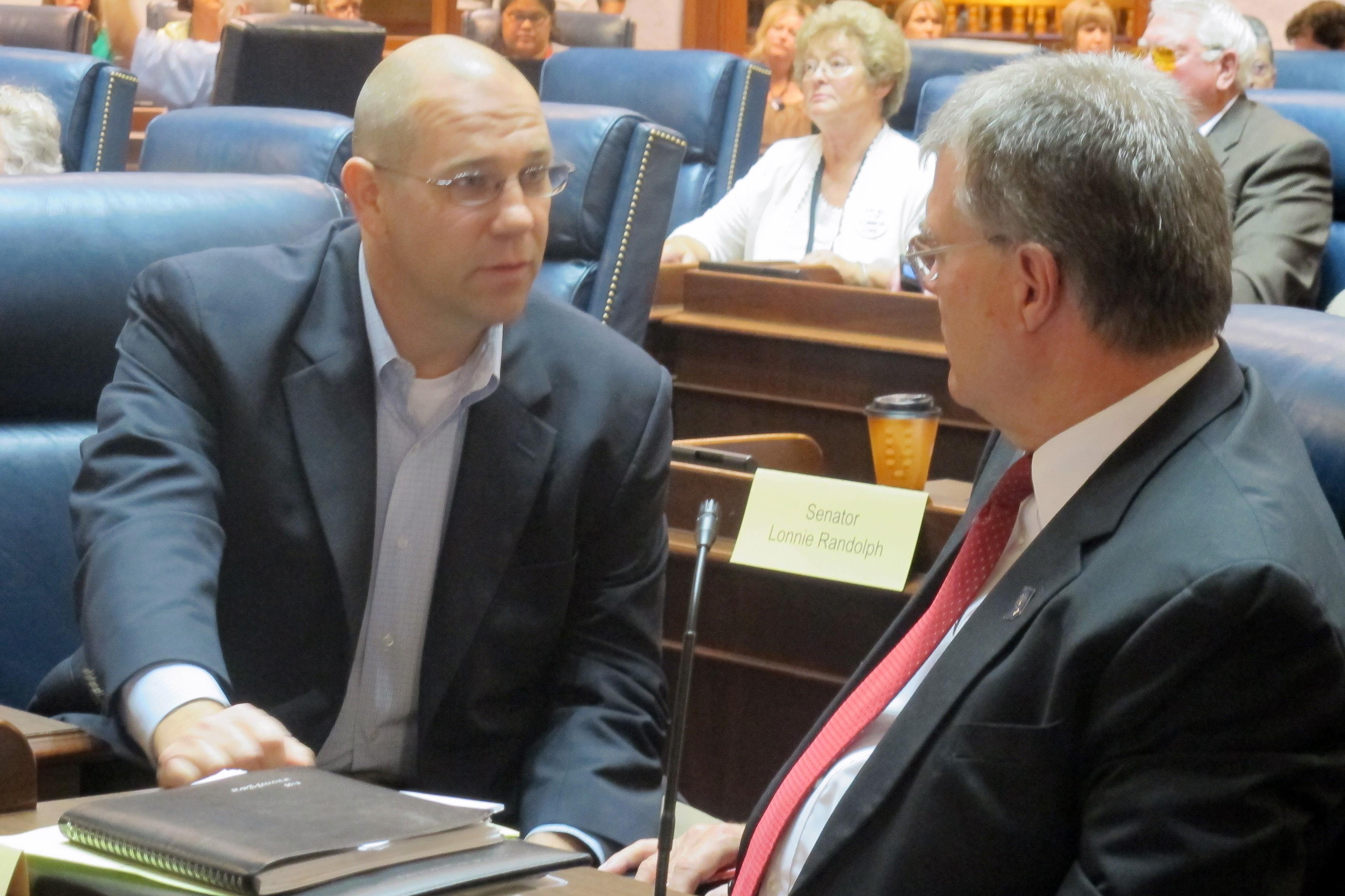 Sen. Scott Schneider, R-Indianapolis, talks with Sen. Tim Skinner, D-Terre Haute, during a summer legislative hearing on the Common Core academic standards.