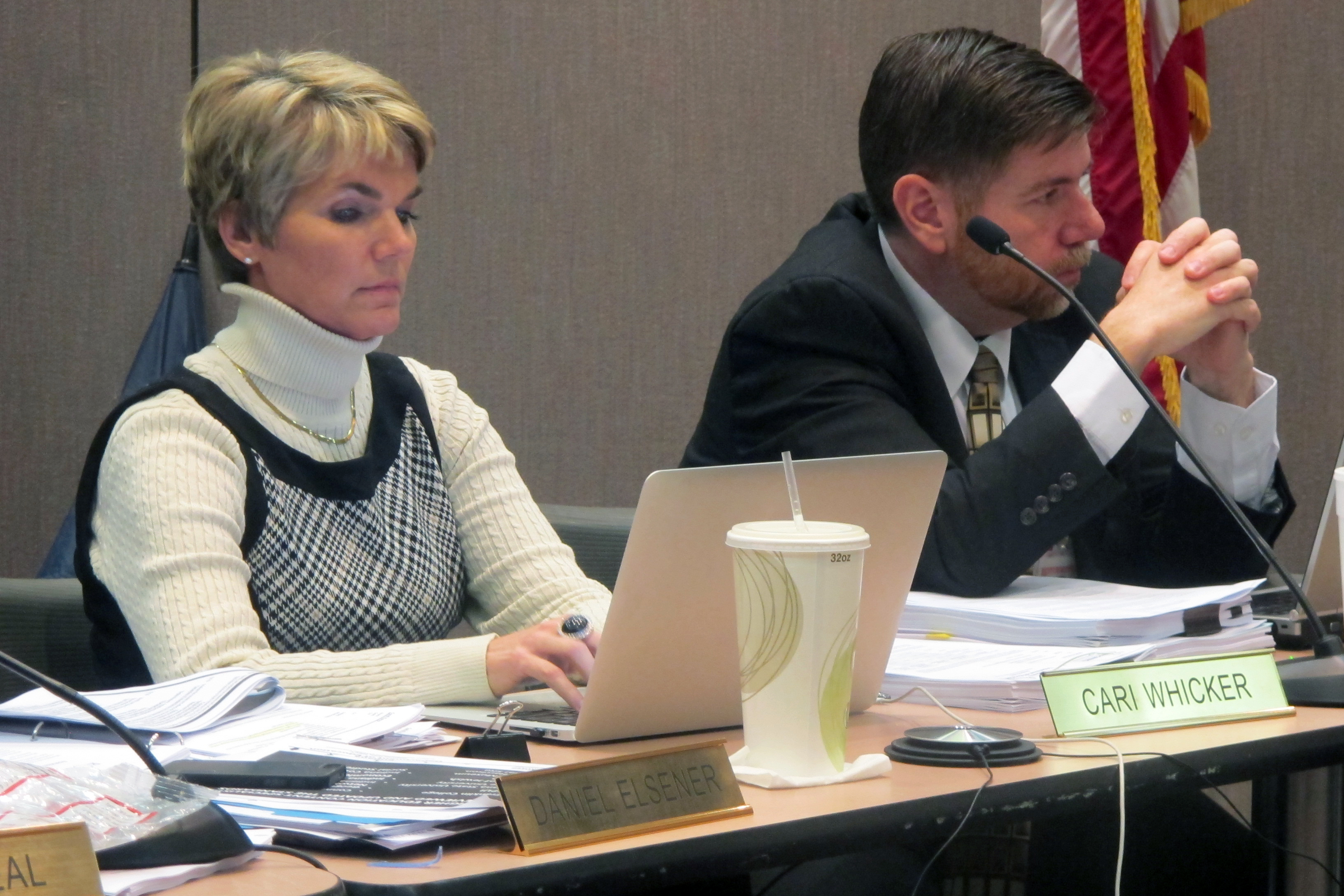 State Board members Cari Whicker, left, and Brad Oliver listen during a presentation on new social studies standards.