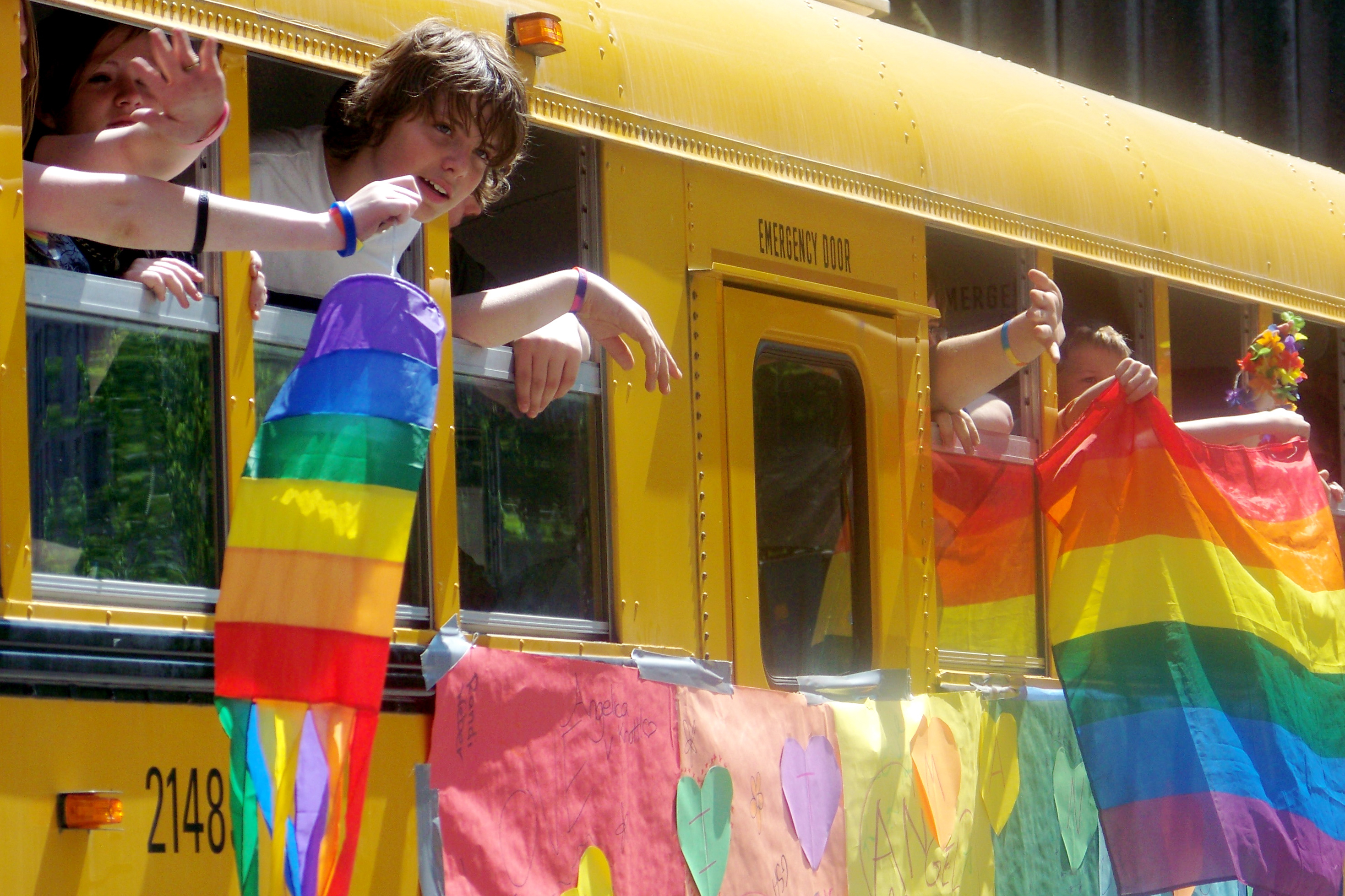 school bus with gay pride banners
