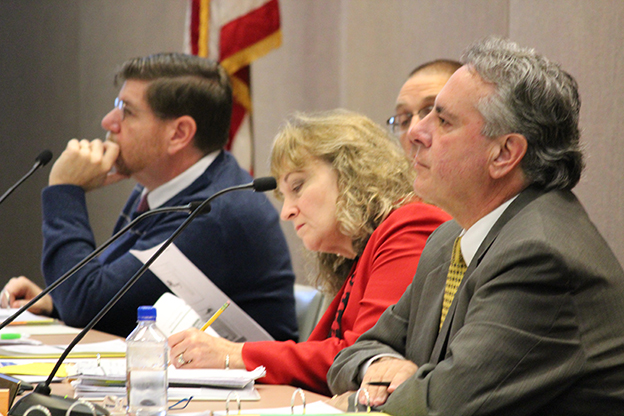 State Board of Education members Brad Oliver (left), state superintendent Glenda Ritz, and Dr. David Freitas listen to presentations at the January board meeting. (Photo Credit: Rachel Morello/StateImpact Indiana)