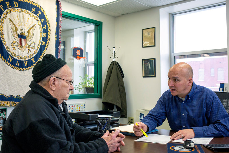 Grant County Veterans Service Officer Bob Kelley, right, works with World War II Army veteran Frederick Kern at the Grant County Government Building in Marion, Ind., on Monday.