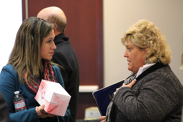 State Board of Education member Sarah O'Brien (left) says the estimated cost for the upcoming ISTEP+ tests concerns her. (Photo Credit: Rachel Morello/StateImpact Indiana)
