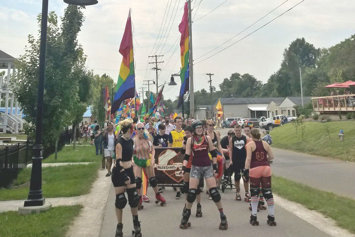 Bloomington's first Pride Parade was led by members of the Bleeding Heartland Roller Derby.