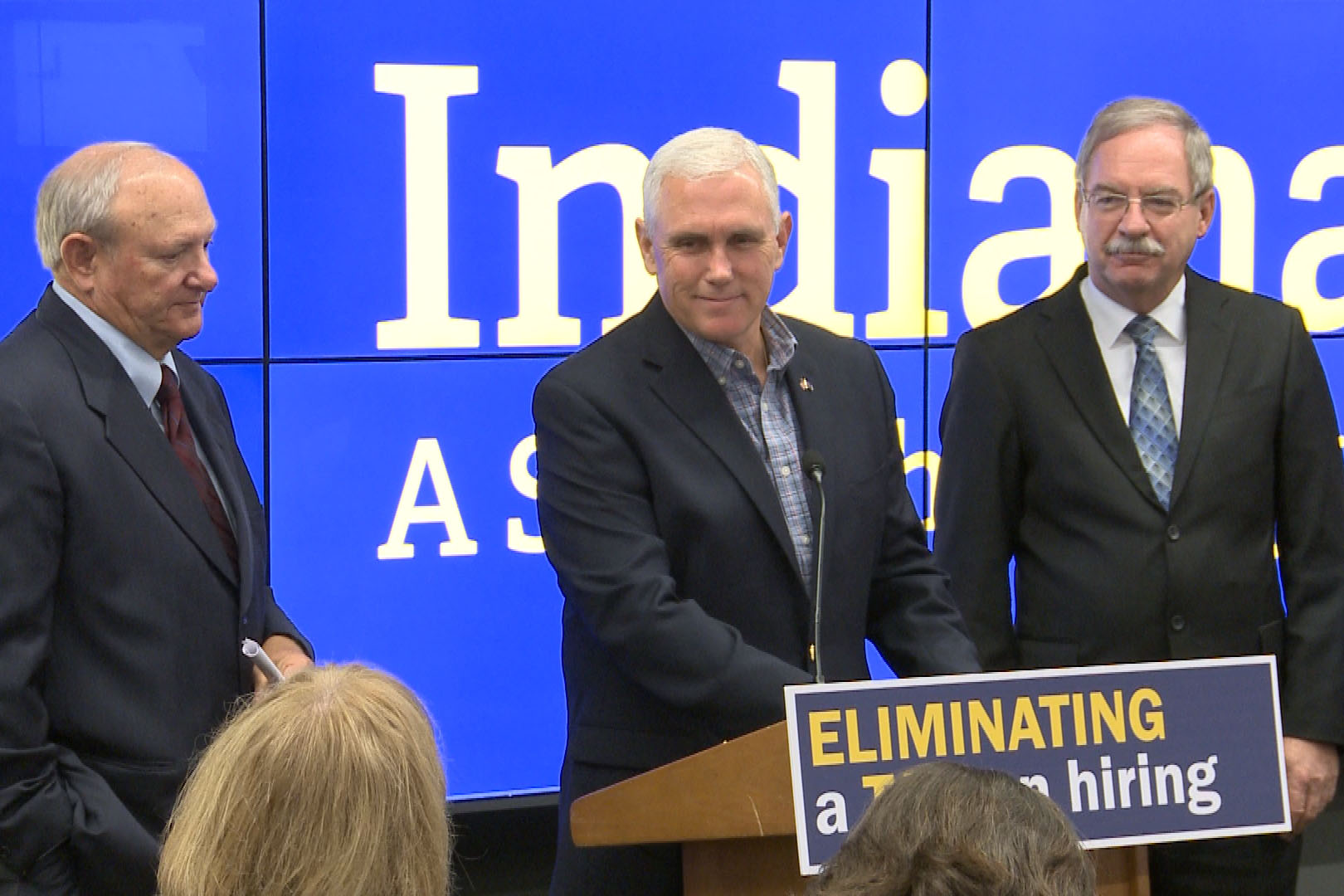 Governor Mike Pence, announcing the pay off, is flanked by Sen. Luke Kenley (R-Noblesville) on his right and Rep. Dan Leonard (R-Huntington) on his left.