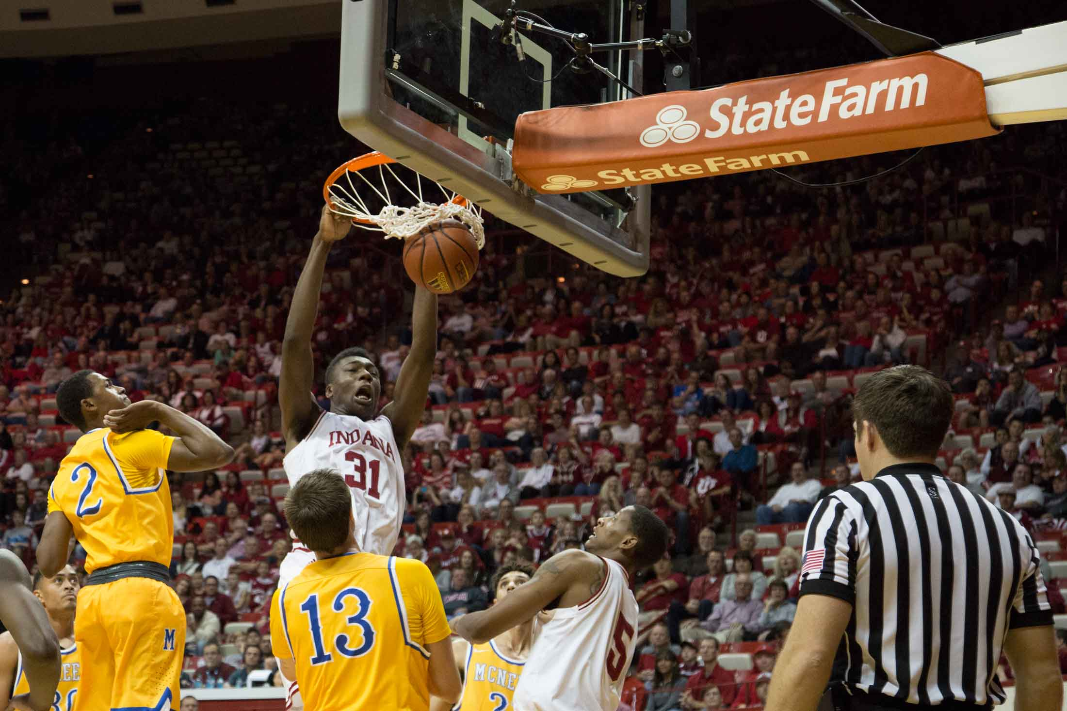 Thomas Bryant throw down a dunk in the second half of a game against McNeese State. The Hoosiers won, 105-60.