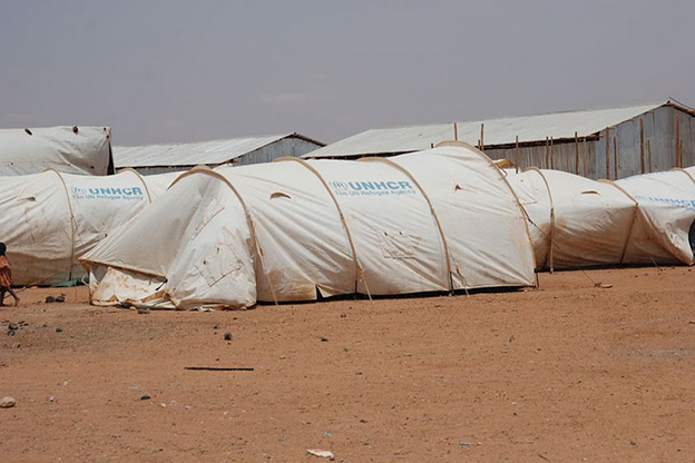 Refugees stay in tents provided by the UN refugee agency at transit centers while they await placement in a more permanent camp.