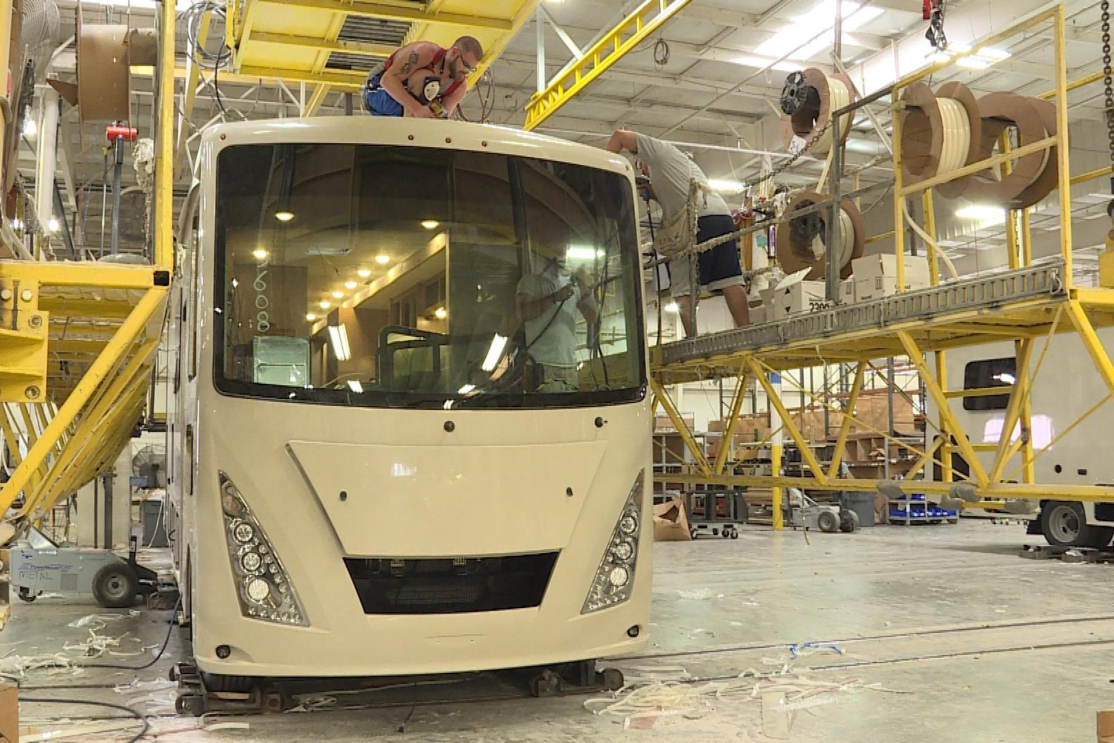 Workers assemble a new RV at Thor Motor Coach's Plant 750 in Elkhart.