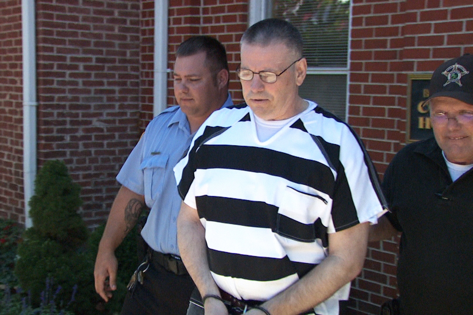 Daniel Messel is escorted out of the courthouse after receiving his 80 year prison sentence.