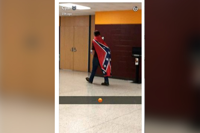 Three students wore a Confederate flag as a cape at Bloomington High School North Wednesday.