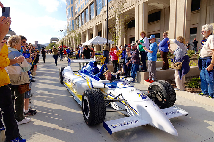 Retired IndyCar driver Sarah Fisher navigates the final leg of the Bicentennial Torch Relay through a crowd at the Indiana Statehouse Saturday, October 15, 2016.