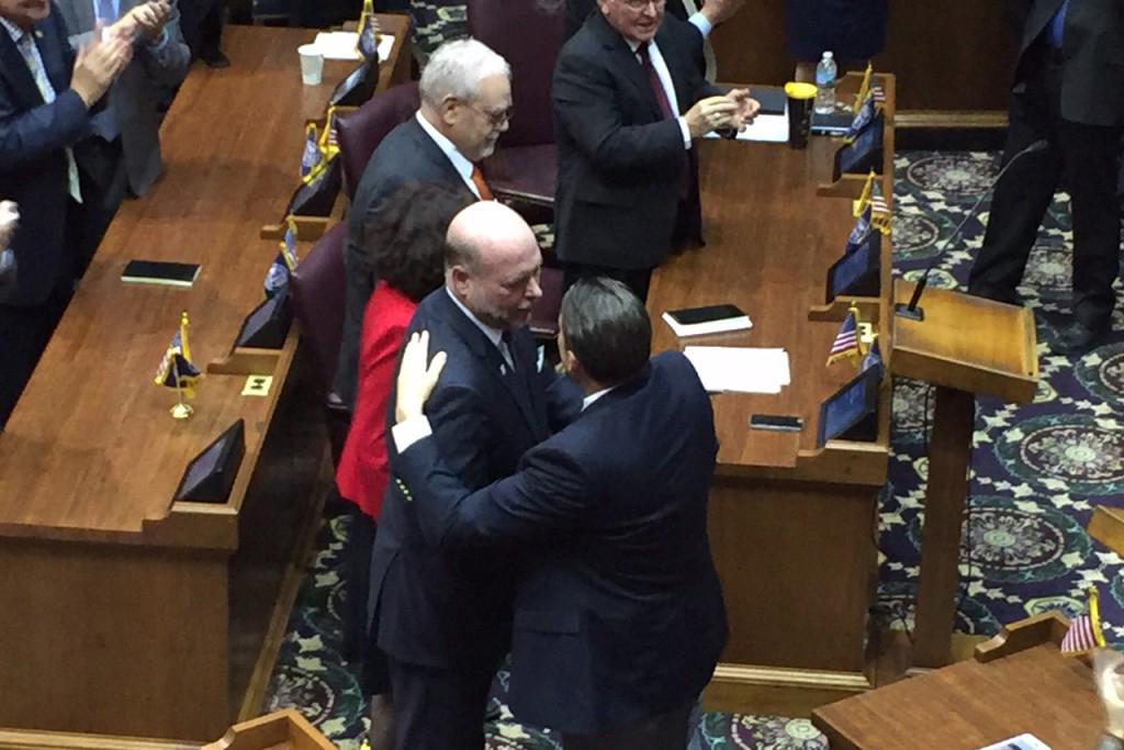 House Speaker Brian Bosma (center) embraces Minority Leader Scott Pelath embrace after Bosma's reelection as Speaker.