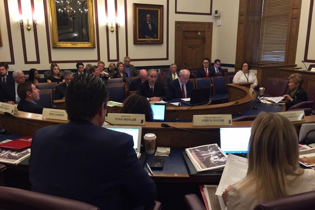 Indiana University CFO John Seidinaj and VP John Applegate present to the State Budget Committee.