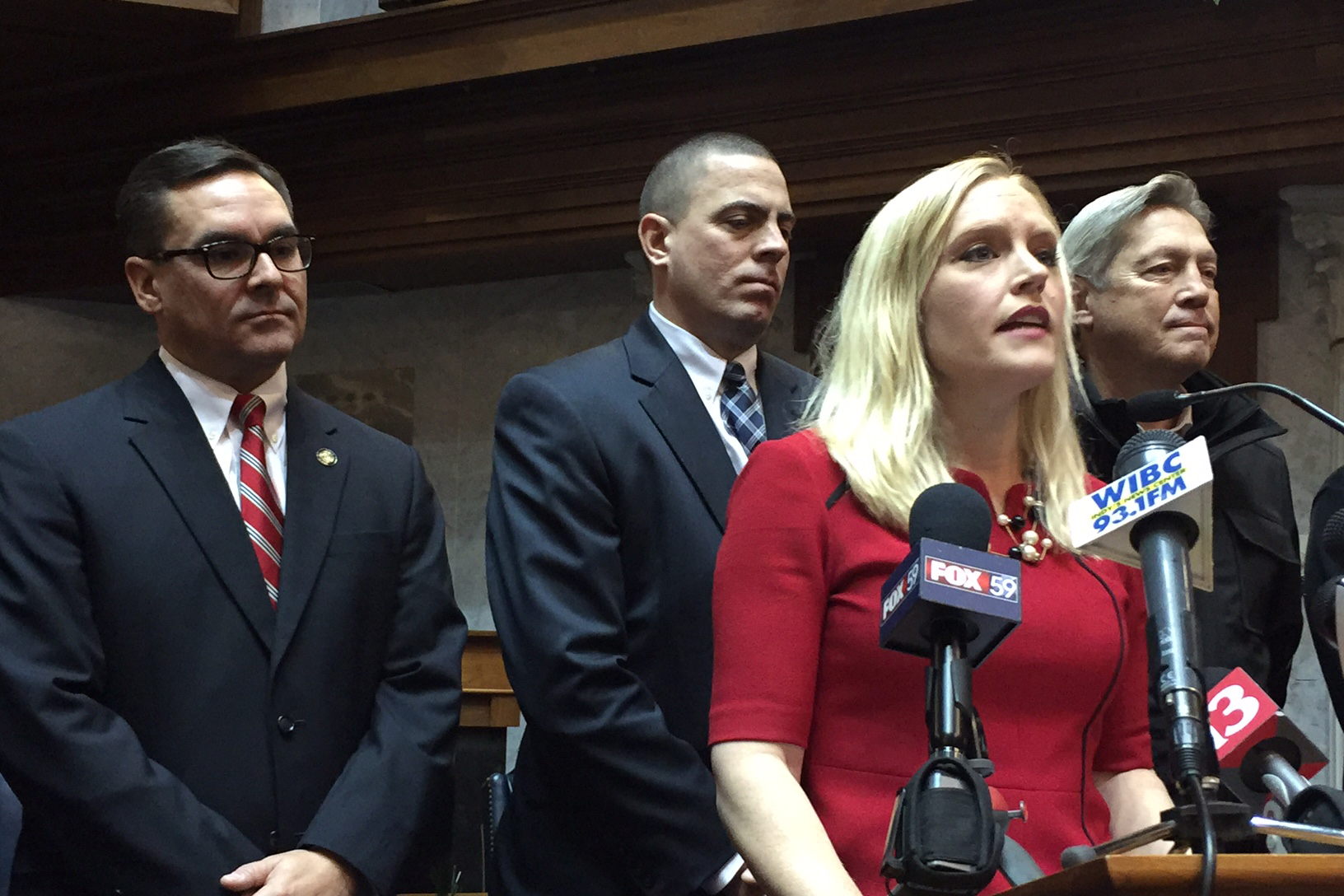 Sen. Erin Houchin (R-Salem) discusses a bill to allow police to collect DNA samples from anyone arrested for a felony. Behind her are local prosecutors, including Boone County Prosecutor Todd Meyer, at left.