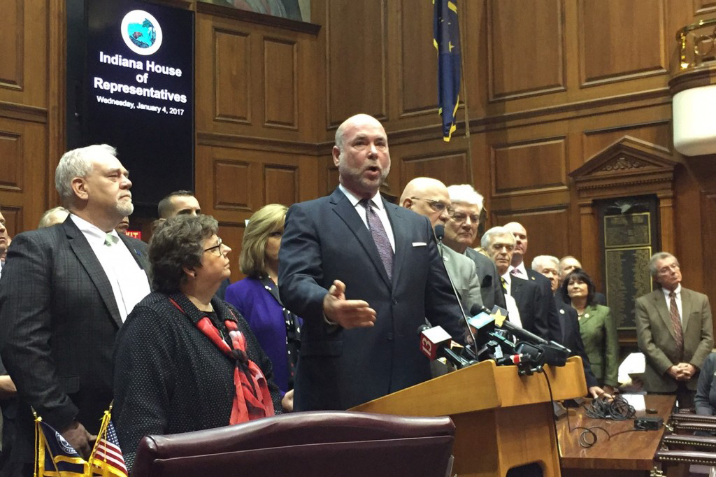Speaker Brian Bosma (R-Indianapolis) discusses the House GOP road funding plan while surrounded by members of his caucus.