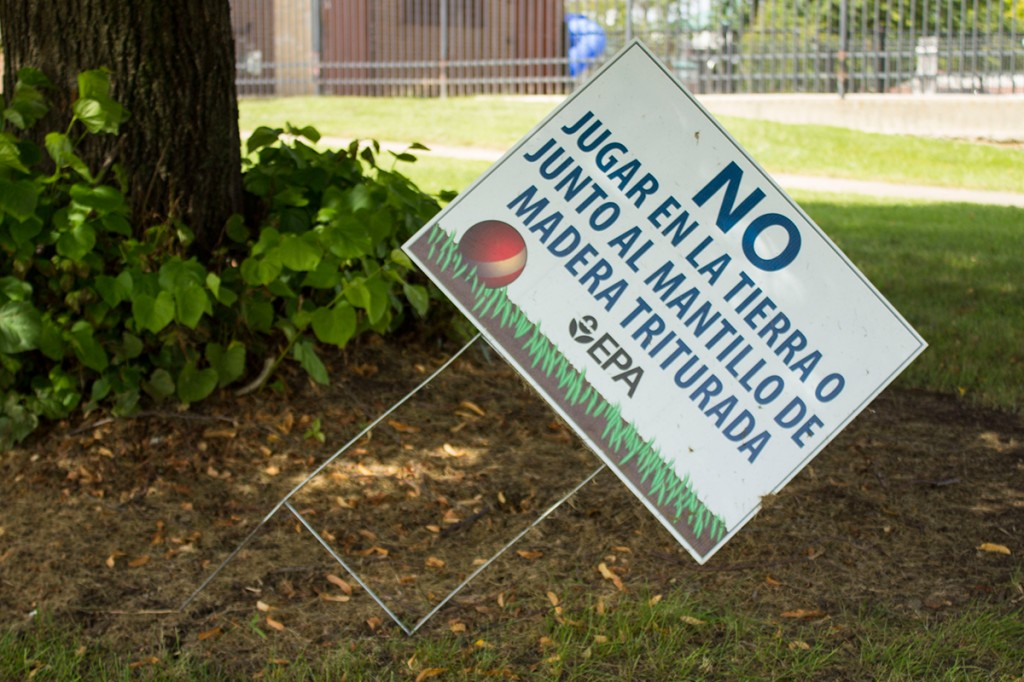 A sign from the Environmental Protection agency warns residents not to play in the soil.