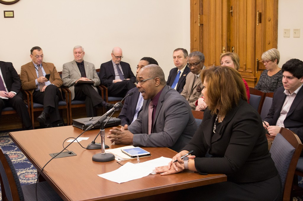 East Chicago Mayor Anthony Copeland, center, testifies before the state Senate Appropriations Committee.